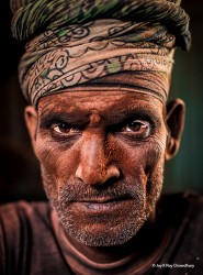 A labour of a brick field, this man was having a break from his shift when I caught him. His eyes were sharp and expressed his dignity defying his economic condition and the physically taxing job he is into. His gaze own over my respect.