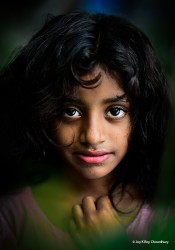 I was travelling to a nearby village with a colleague. It was just for the sake of travelling we were roaming. Sometimes by walk, sometimes by rickshaw. We even crossed a small river to reach the village on the other side. There I saw this angel face. My eyes of a photographer were dying to capture her innocence; but I was not carrying a camera. Seeing my urge, friend lent me his gear; and I, at once, framed those heavenly eyes full of innocence.