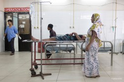 A woman attending her husband before entering the OT of the casualty of a medical college hospital.