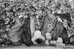 Ragpickers sleeping in the garbage store, New Delhi Railway Station.