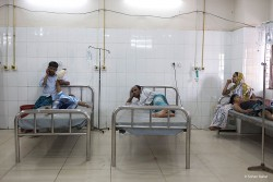 are waiting in the casualty department of a medical college hospital